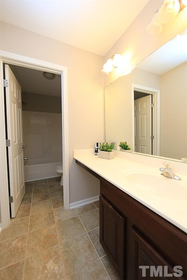 The hall bathroom has a separate area for the tub/toilet.