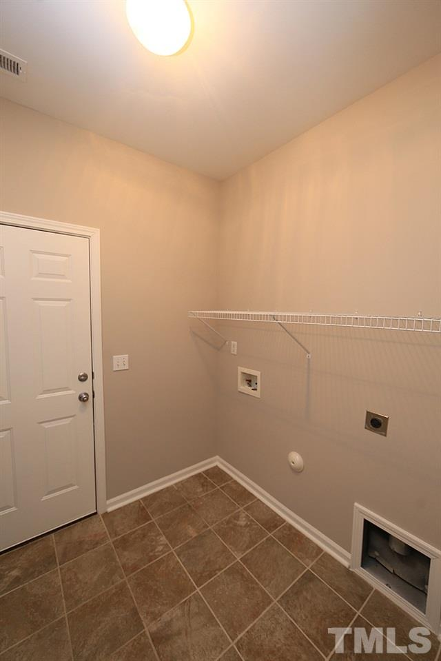The laundry room is conveniently located on the main floor with access to the garage.