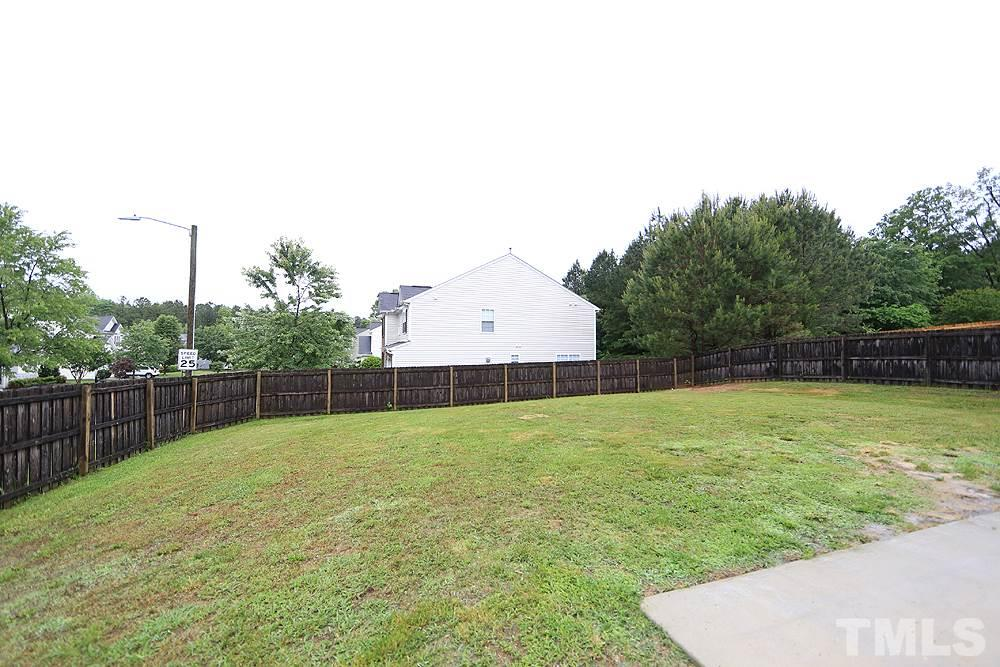 A fenced backyard with lots of potential and room to garden/play/landscape.