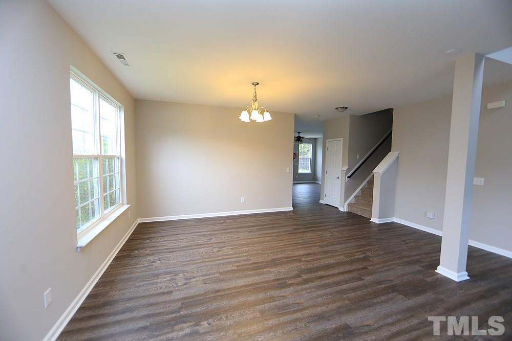 Enter the home and to the left is the living room which opens to the dining room.  The entire interior has just been painted and new luxury vinyl plank flooring and new carpet has been installed.