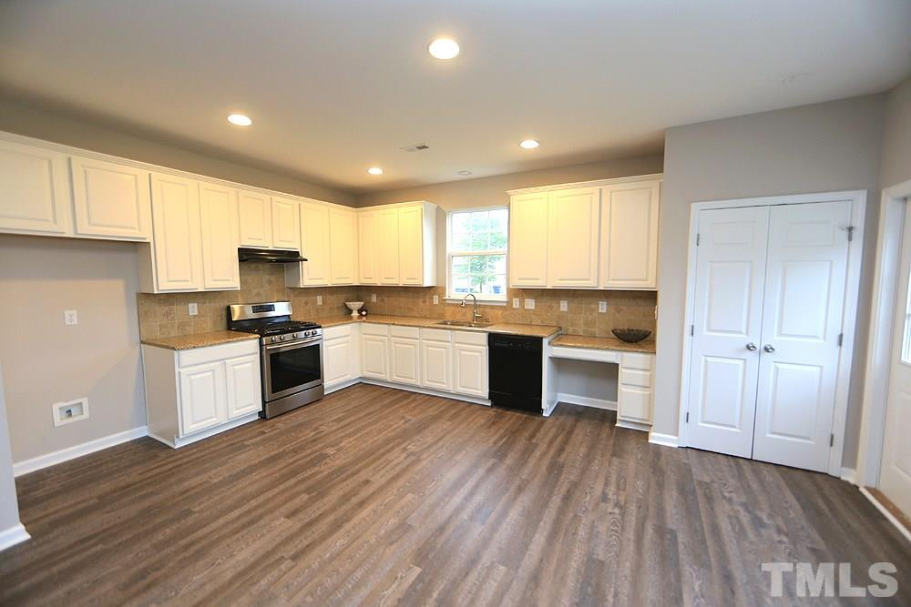 Large kitchen with painted cabinets.