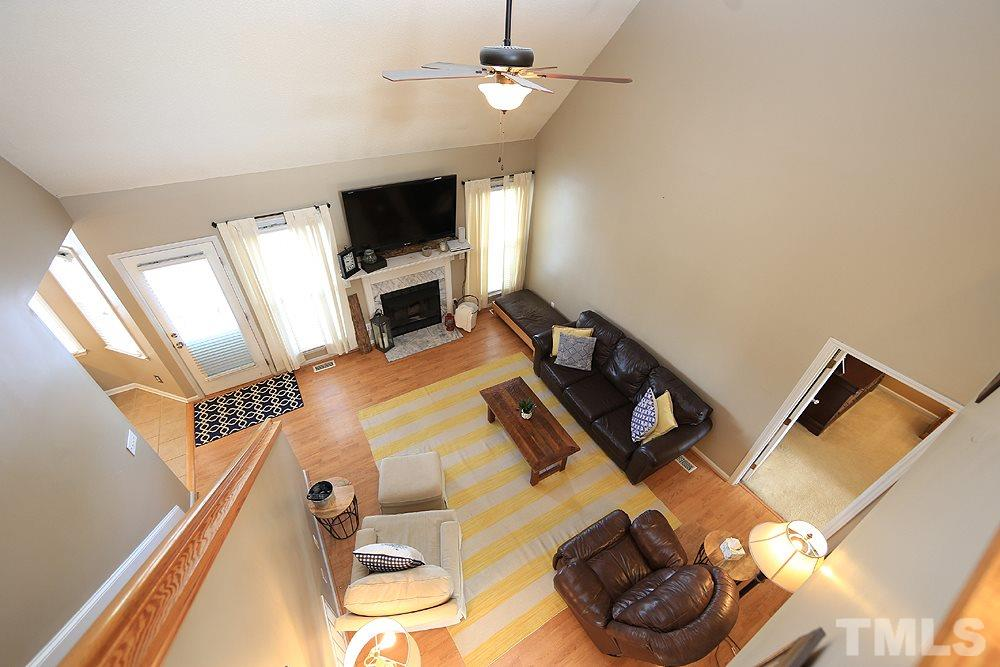 Secondary bedroom with hardwood flooring and ceiling fan.
