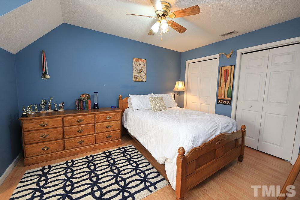 Spacious upstairs bath has large window and vaulted ceiling!