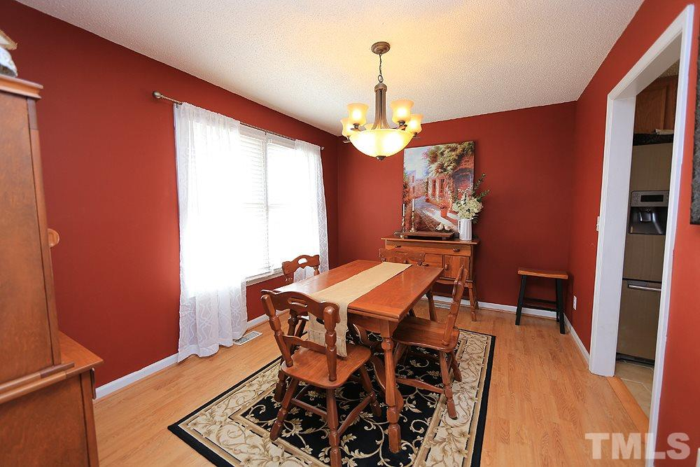 Dining Room with hardwood flooring and large windows.