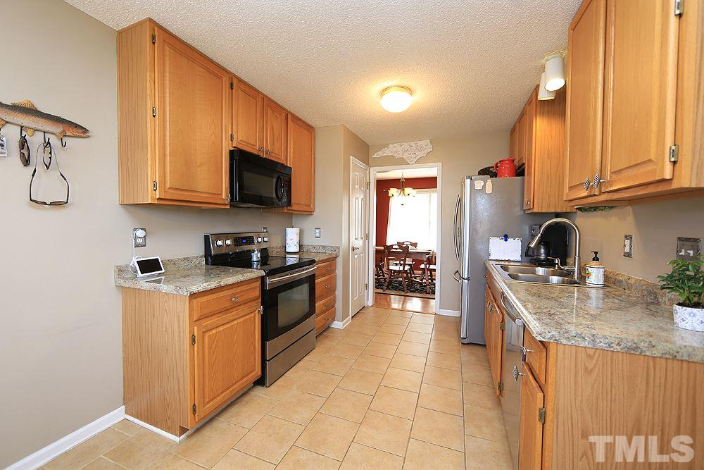 Stainless steel appliances, tile flooring and pantry for additional storage. Refrigerator conveys!