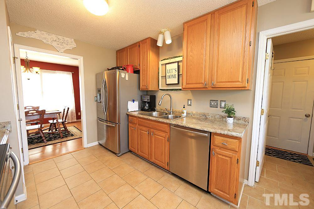 Tons of cabinet space! Laundry room is off the kitchen and provides access to the 22x28 garage.