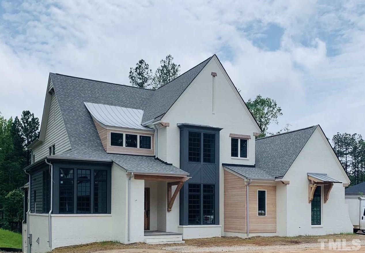 House currently under construction. Photo is of similar home built by seller in another community and is only representative. Please contact onsite agent for details.