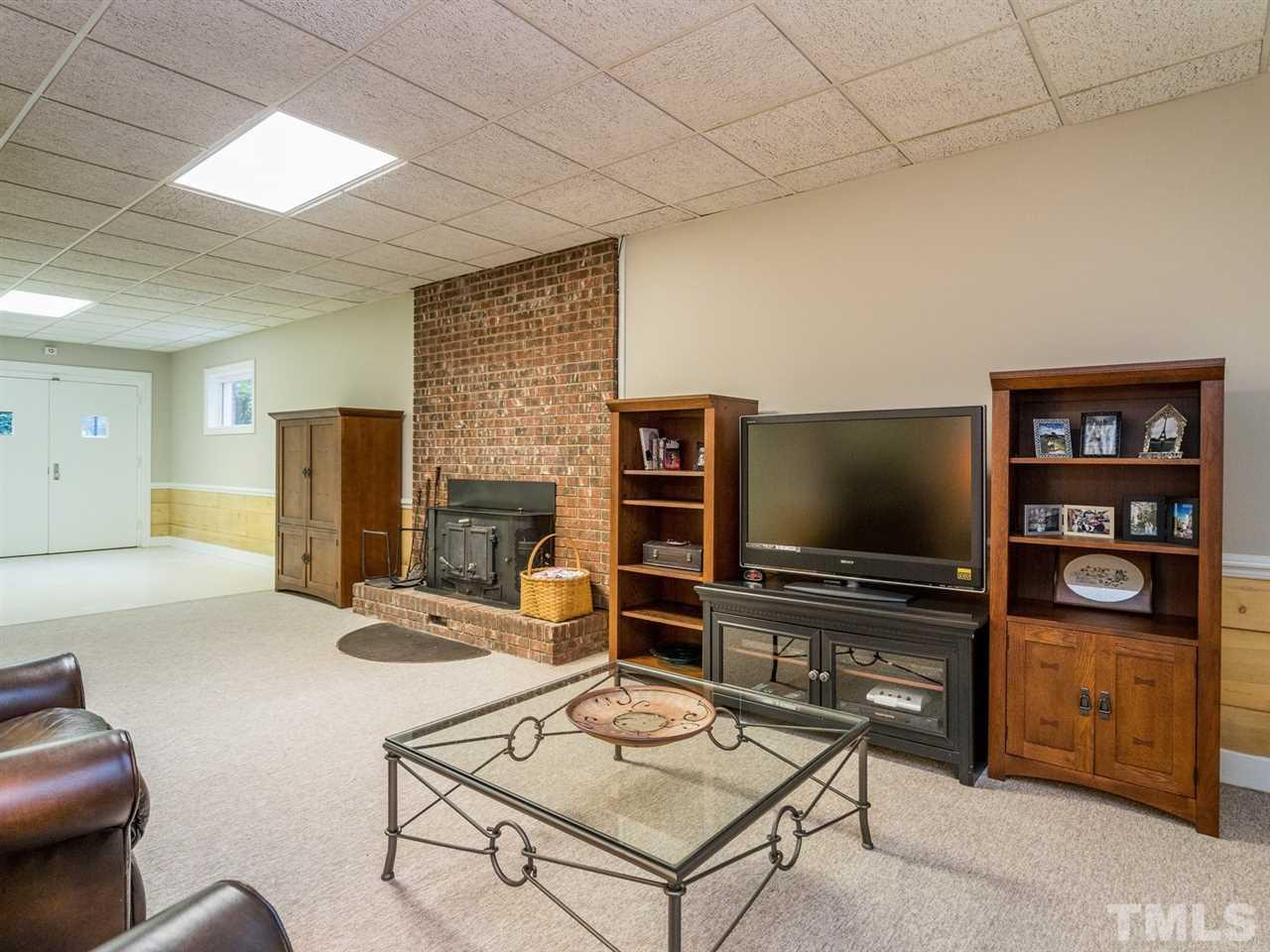 The bonus room is quite spacious and boasts a wood stove.