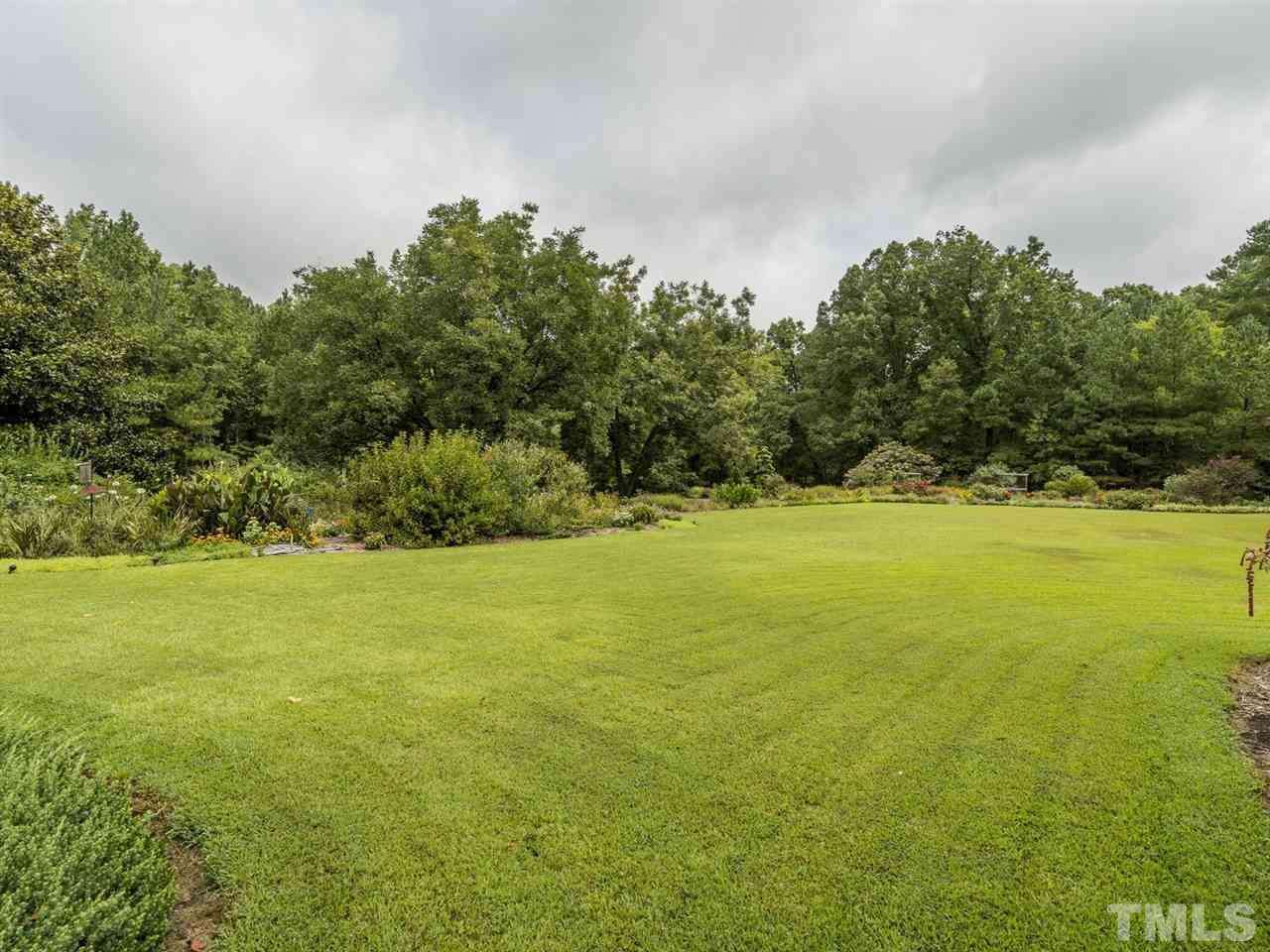 This home is nestled on 6.82 acres and more land is available for sale.