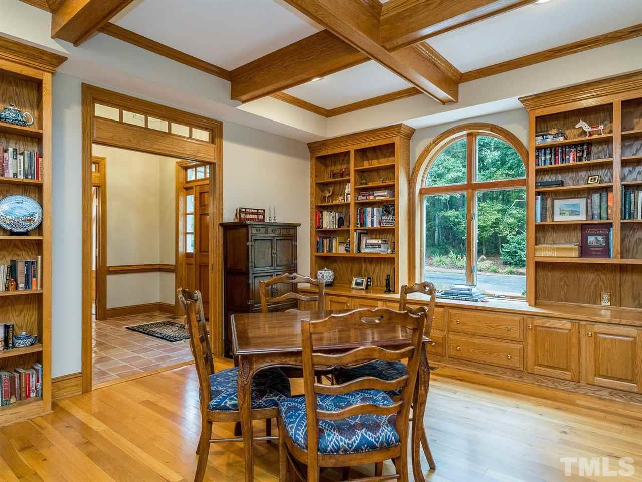 The impressive study comes with custom-built in cabinetry and a coffered ceiling.
