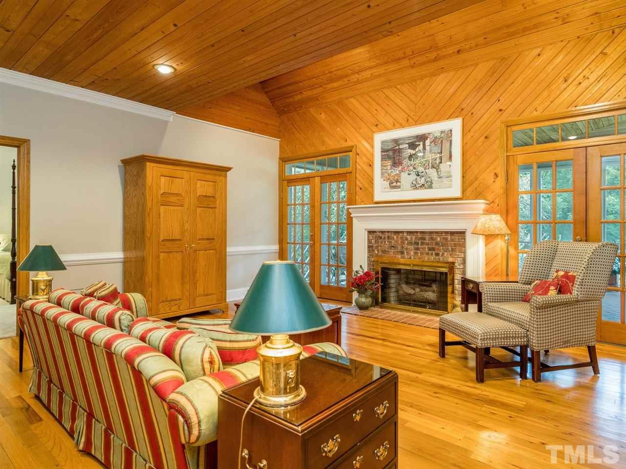 The spacious family room has a beautiful Cypress ceilings.