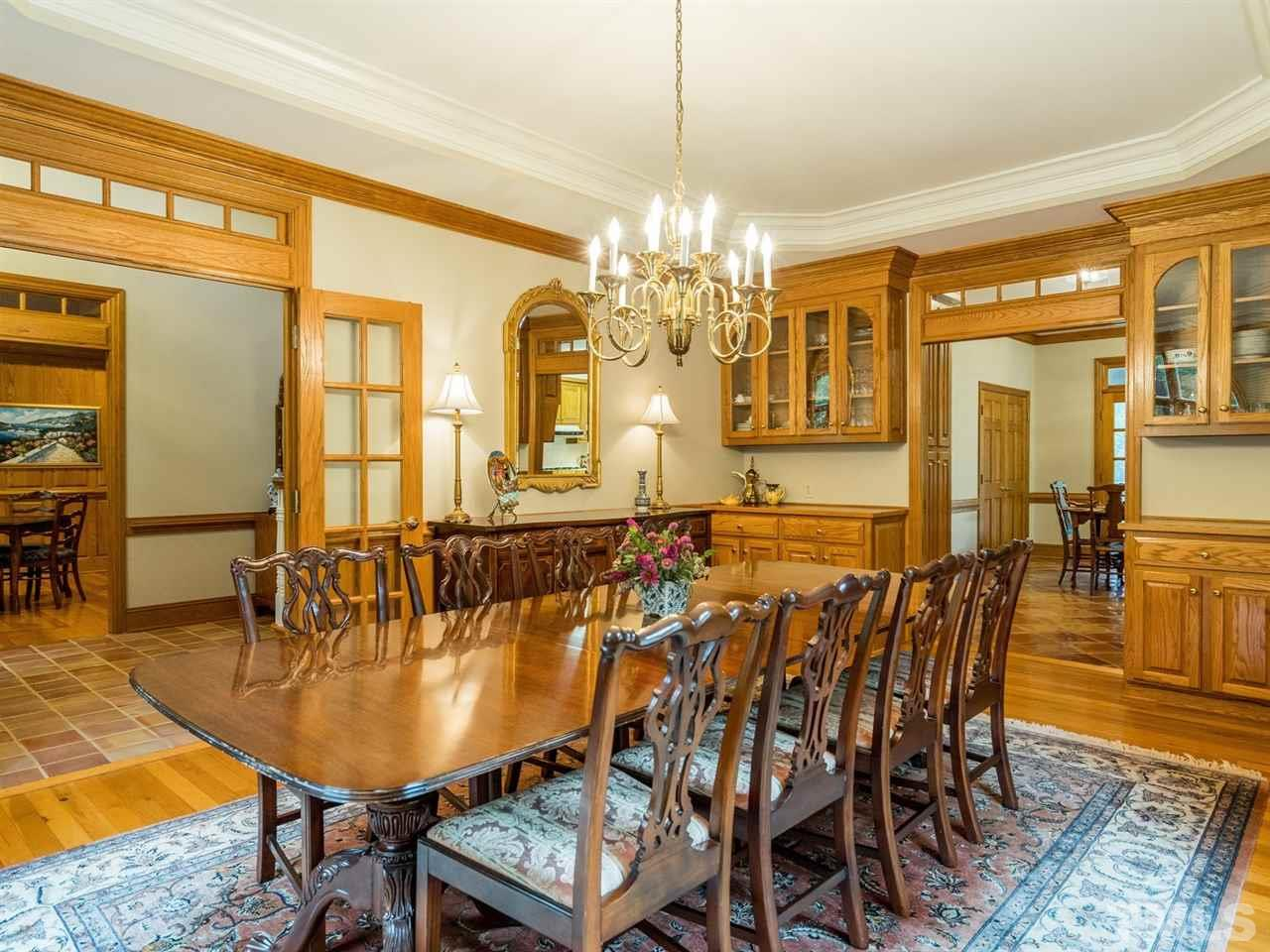 Imagine hosting holiday meals or family celebrations in this elegant room.  The trey ceiling and wainscoting add charm and character.