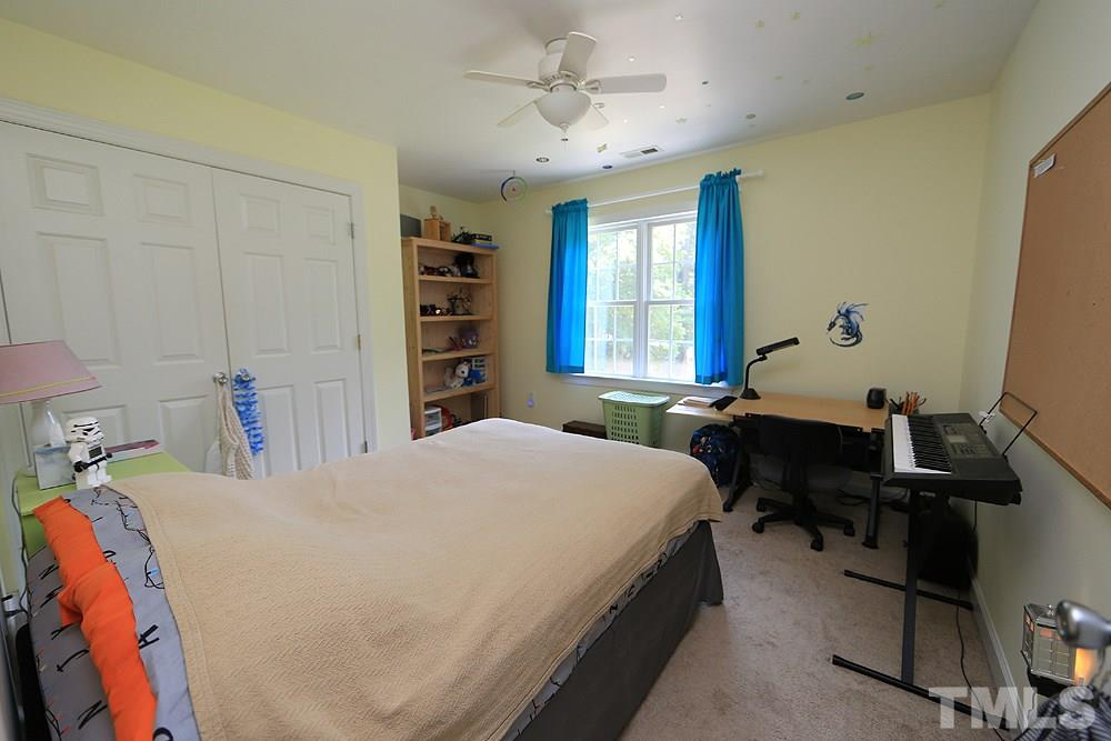 This secondary bedroom is roomy and faces the front yard.