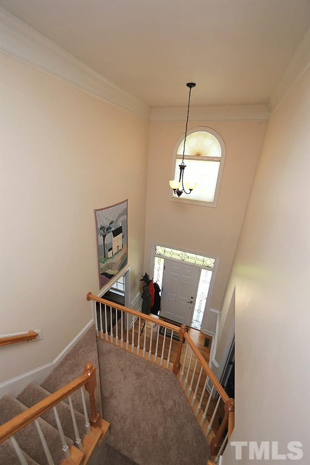 Newly carpeted stairs accentuate this stunning 2-story entry foyer.