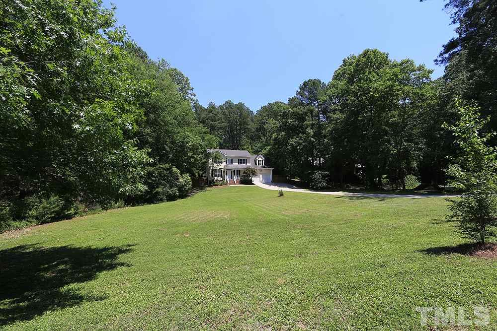 Expansive, sun-filled front yard ideal for recreational play or a gardener's touch.