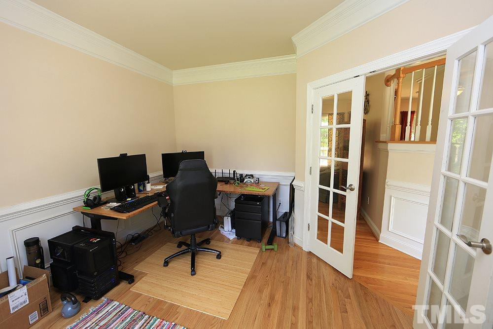 First floor office/study features french doors for privacy.
