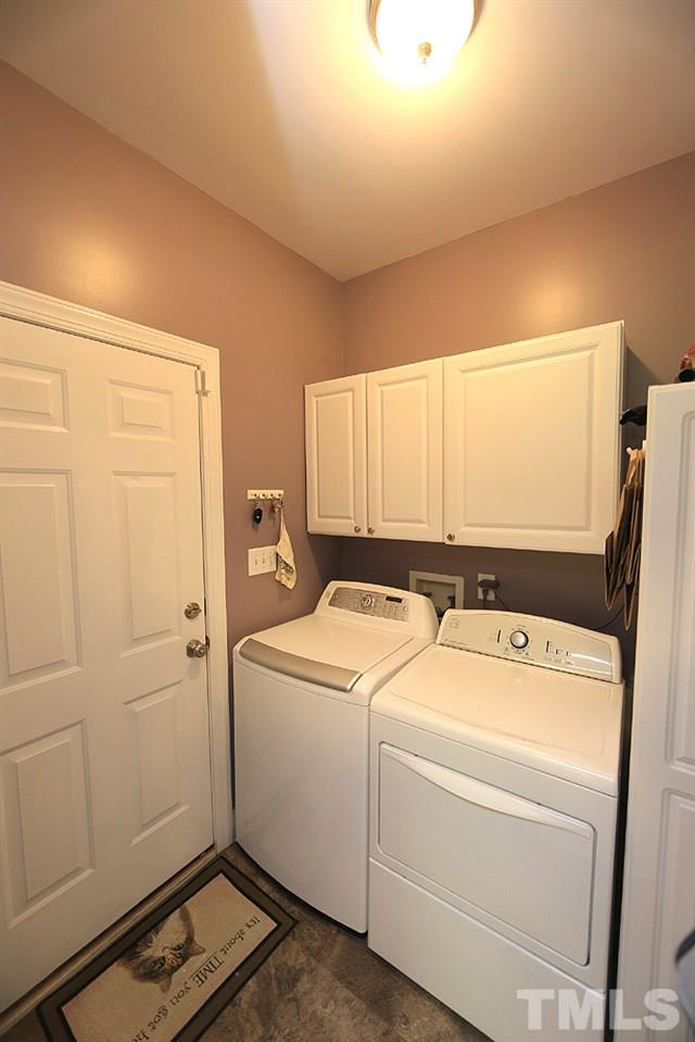 Main floor laundry located just off the garage also serves as a mud room.