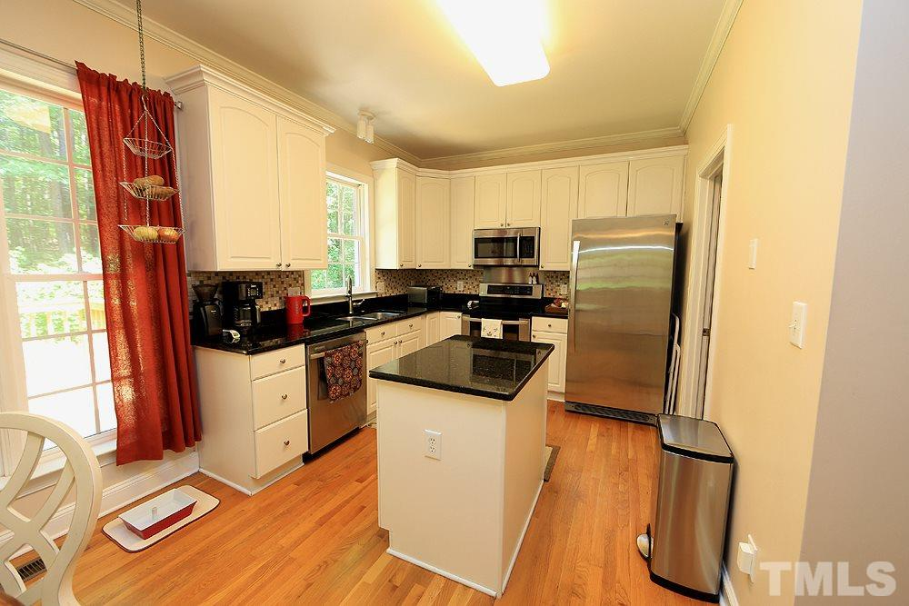 Warm and inviting kitchen with contemporary granite counters and stainless steel appliances.