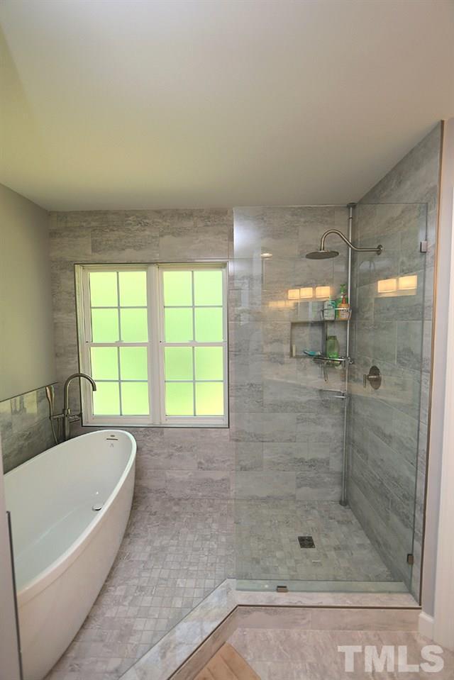 Handsomely updated master bath suite with doorless walk-in shower.