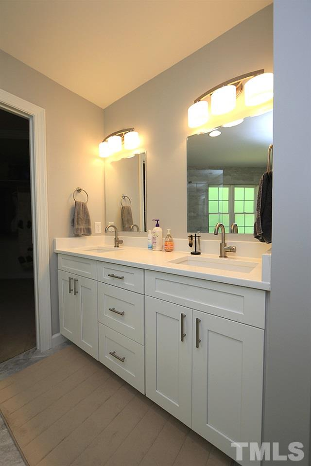 Updated dual vanity absolutely sparkles and sits adjacent to large walk-in closet.