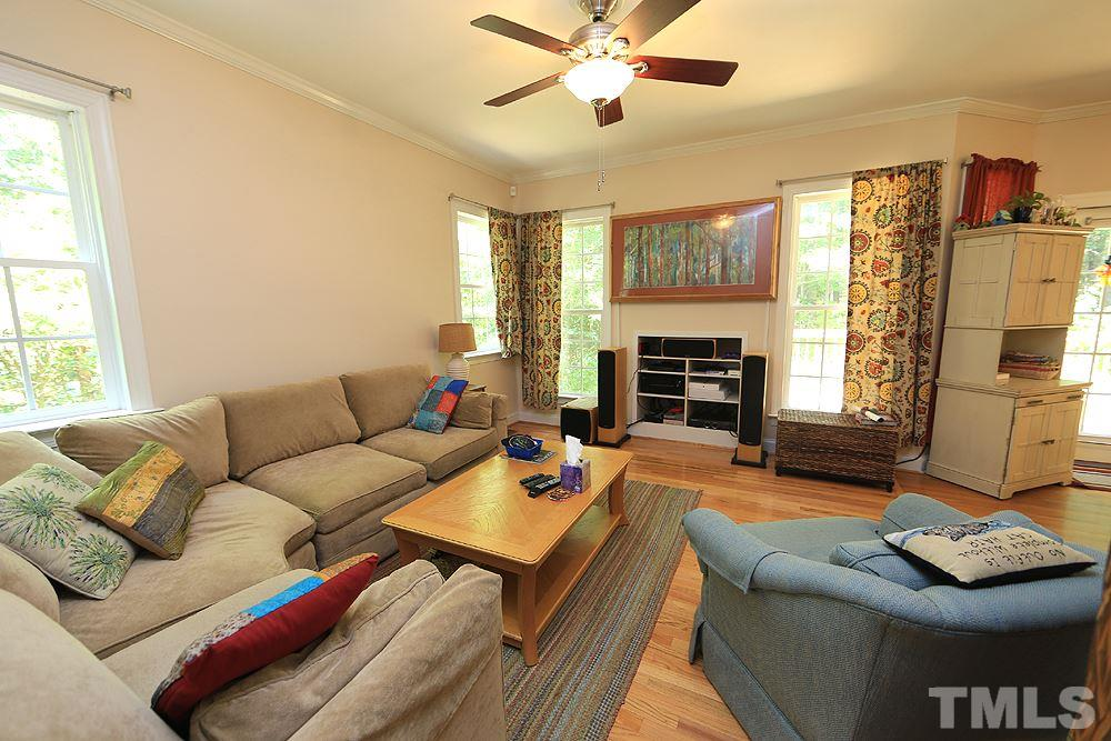 Cozy family room. Two Nest thermostats and wireless alarm system convey with the house.