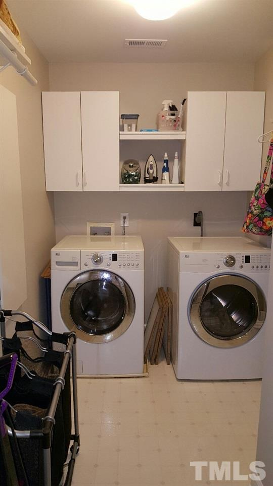 Fantastic Laundry Room upstairs has tons of room for cabinets & even a built in ironing board.