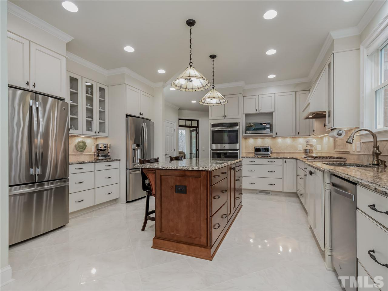 Immaculate Kitchen with SS Appliances, Double Oven, Two Refrigerators, Under Cabinet Lighting, and Center Island.