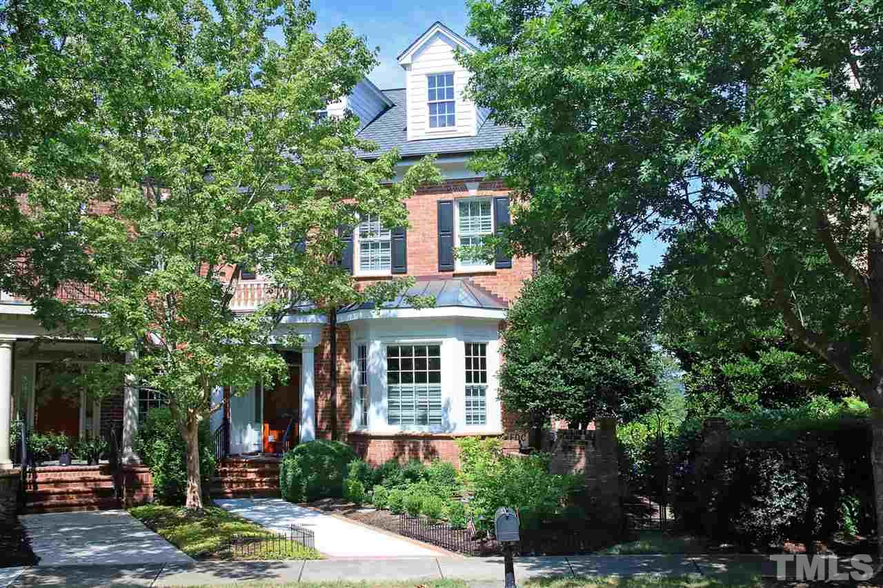 Lovely brick traditional townhome in Meadowmont, conveniently located to UNC, Duke and Research Triangle Park.