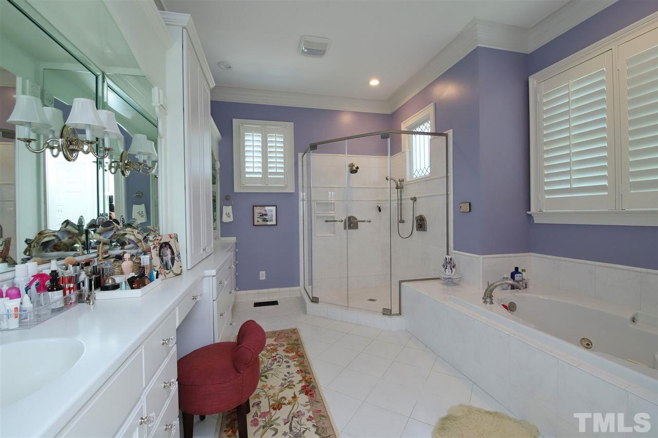 The master bath with double vanities and ample storage space. The shower was newly installed in 2013-2014.