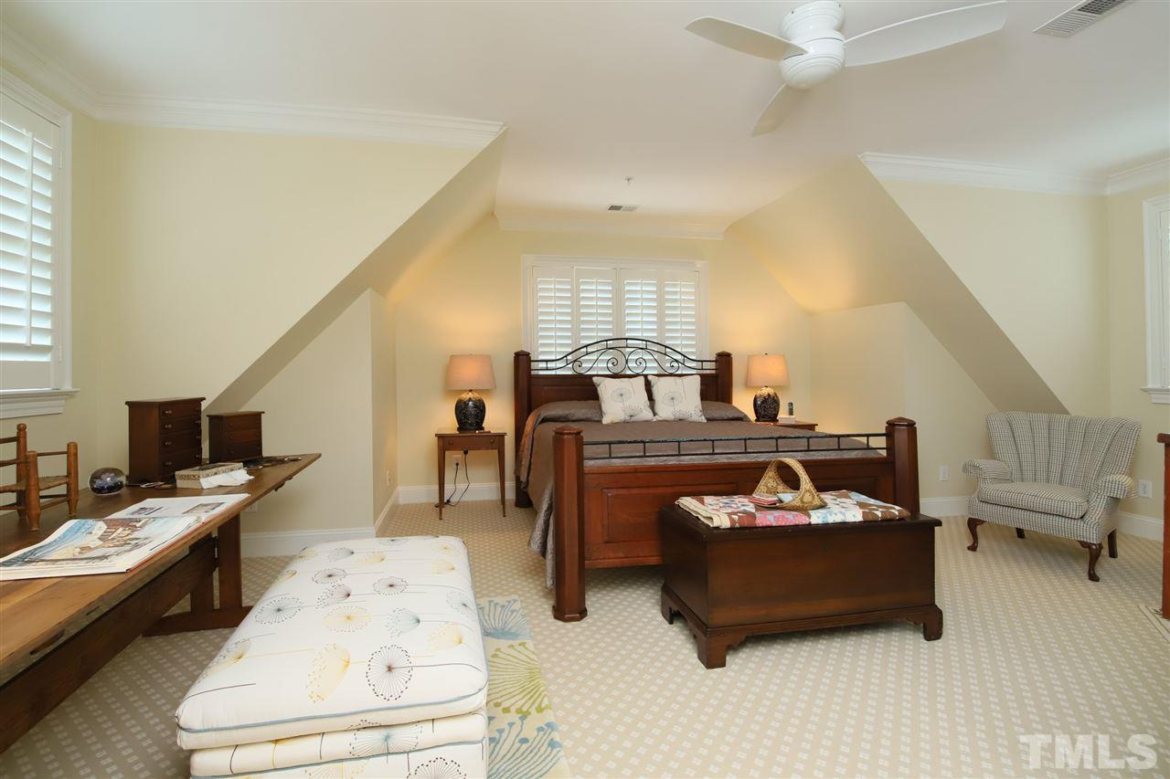 This large bedroom is above the master bedroom on the first floor and features a private bathroom and two closets.