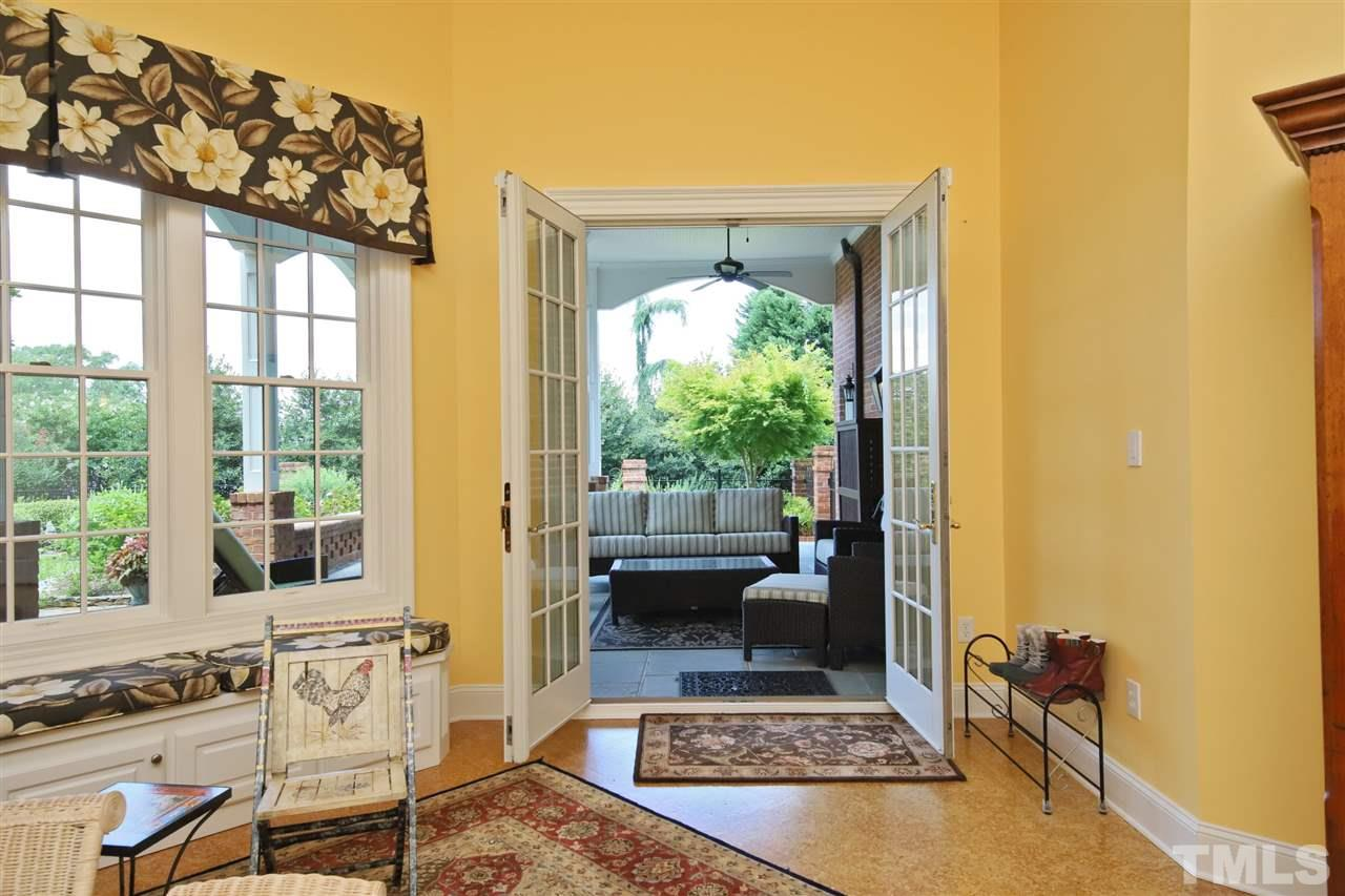 A lovely set of French doors leads to the covered patio and garden at the rear of the home.
