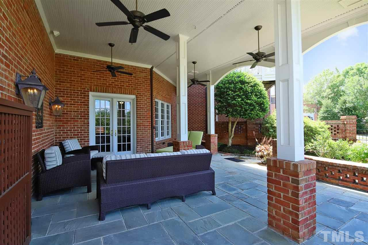 The private patio features four ceiling fans and adjoins a lovely fenced garden at the rear of the home.