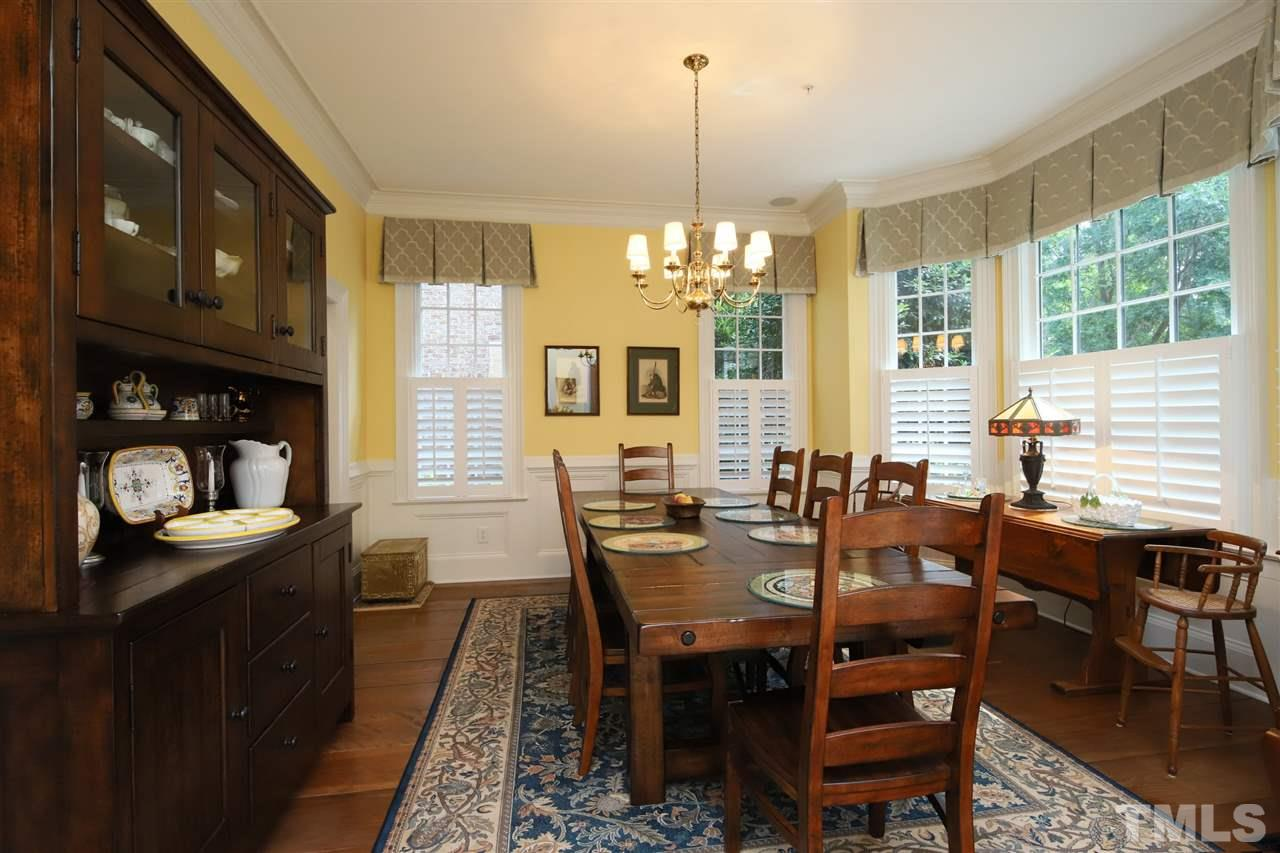 The generously sized dining room is ready to host family and friends.