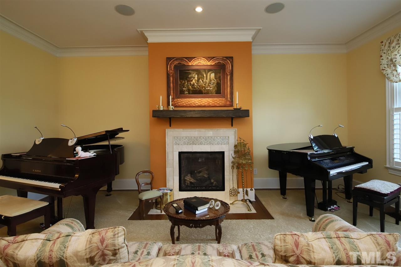 The spacious living room features a gas log fireplace that was completely rebuilt with a new tile surround and mantle.