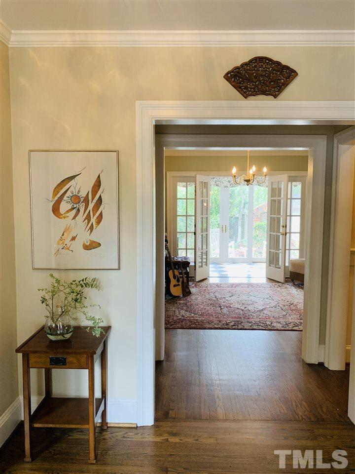 """Bright and functional foyer features a """"drop zone"""" with shelves and hooks for shoes and packages."""