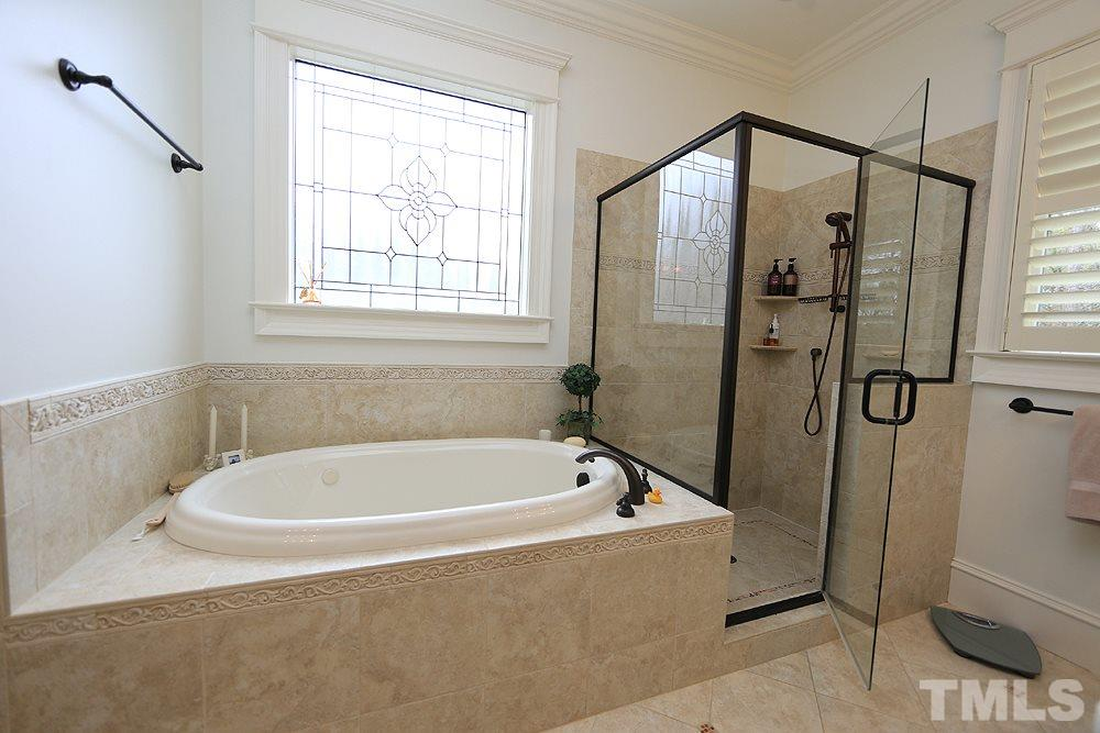 Relax in the oversized whirlpool tub or enjoy the large walk-in shower with removable shower wand.
