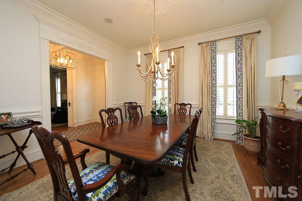 The formal dining room sits to the left of the foyer as you enter the home.  Chair rail, crown molding & a gorgeous chandelier create a luxurious & inviting aura for entertaining.  Hardwoods grace the main floor living except for master suite & laundry.