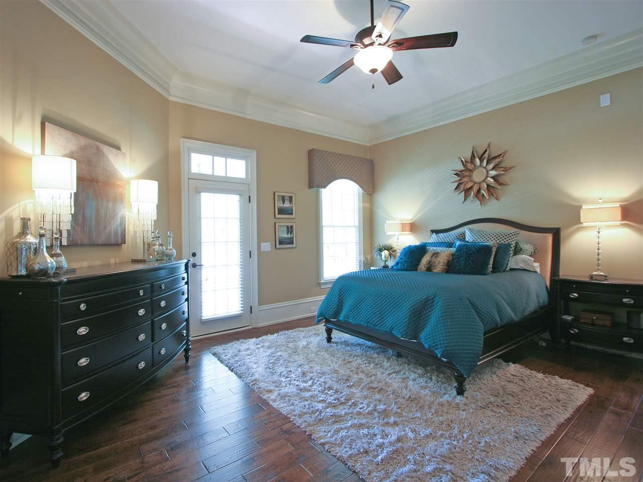 Luxurious master suite is on the first floor and features this spacious bedroom with hardwood floor and a spectacular en suite bath. The master bedroom has direct access to the side porch.