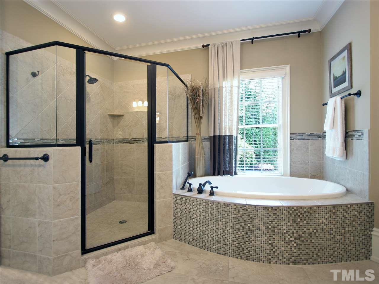Pamper yourself with this luxurious master bath. Large oval soaking tub has custom tile accent. Spacious separate shower has custom tile as well. Window overlooks your private enclosed patio area.