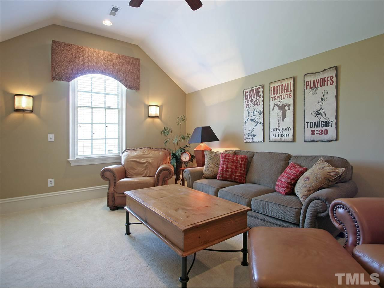 This is one of two bonus rooms in the home. This one, at the top of the second staircase, is the smaller, more intimate, of the two. Watch TV, read, or enjoy conversation with family and friends.