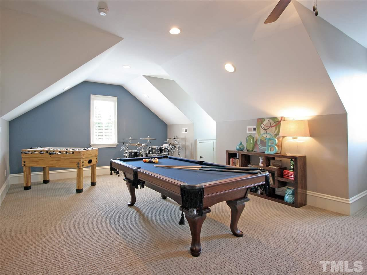 This second, larger, bonus room has room for game tables on one side and a large seating area on the other.