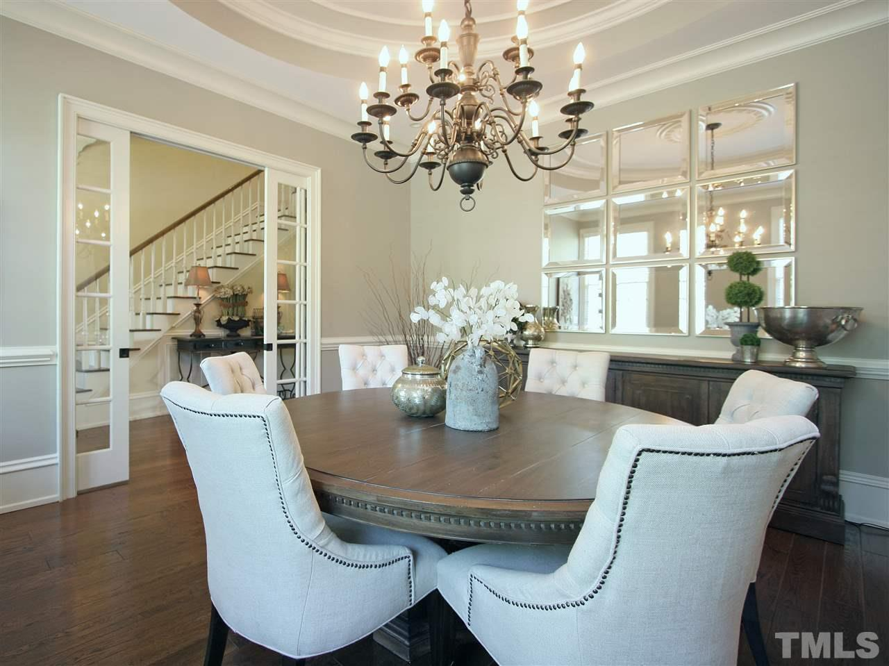 The formal dining room is spacious and affords plenty of room for your larger furniture pieces. This room is accessed from the foyer and also directly from the kitchen.