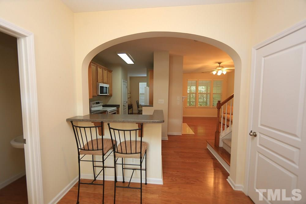 You'll love this wide/spacious foyer with hardwood floors and breakfast bar overlooking the beautiful kitchen.