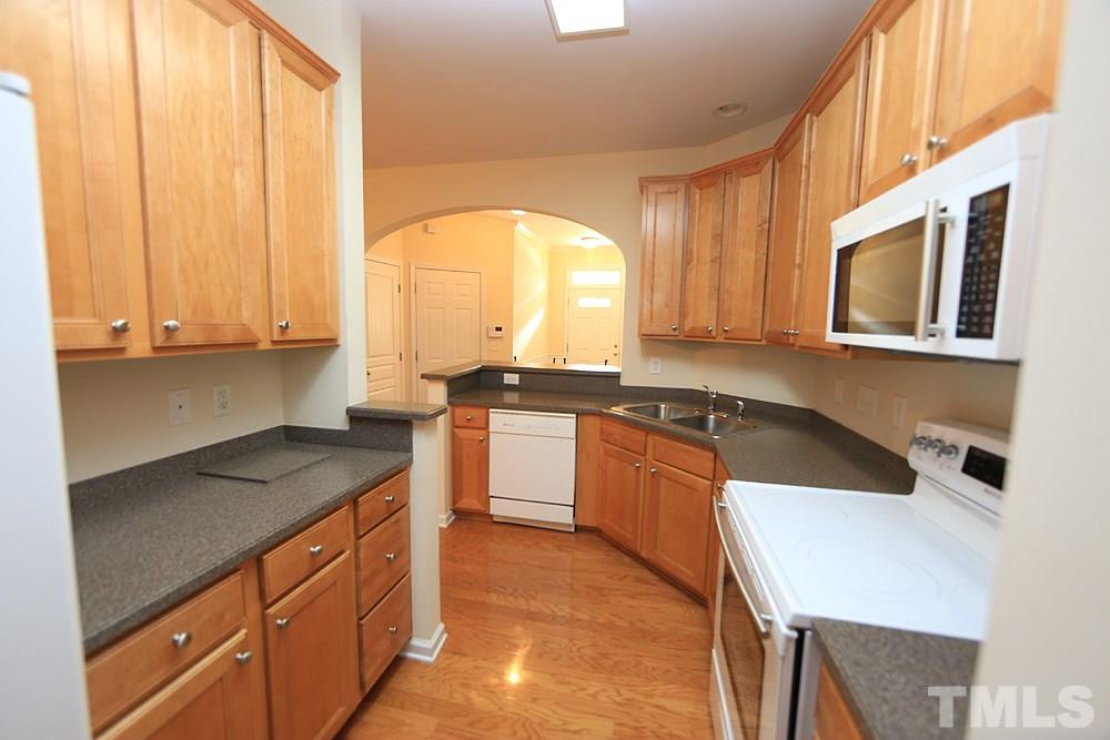 Upgrades galore found in this one-owner townhome. 42-in maple cabinetry, top-end appliances that are as clean as brand-new, solid surface countertops and loads of space to cook and entertain!