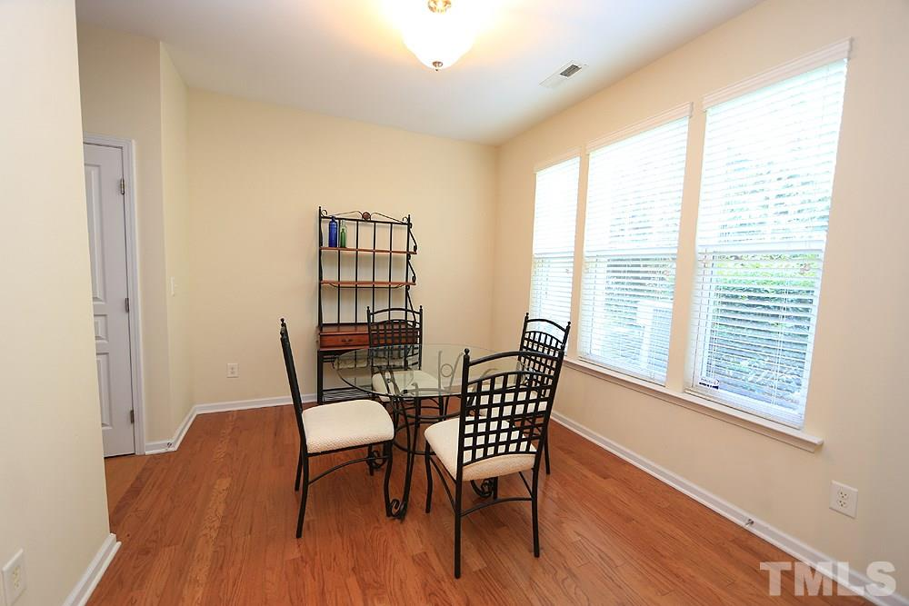Huge dining space with brand NEW hardwood floors just added prior to listing.  Overlooks private back patio/yard.