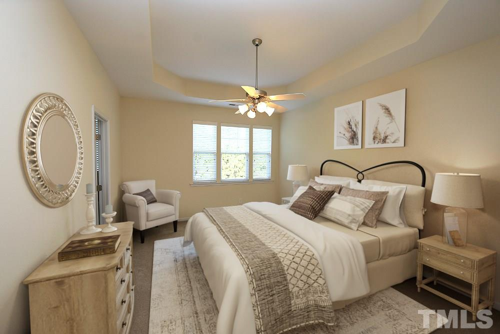 Virtually staged to showcase this spacious master suite.  Trey ceiling, lighted ceiling fan and brand NEW carpet throughout the upstairs.  Don't miss the HUGE walk-in closet, too!
