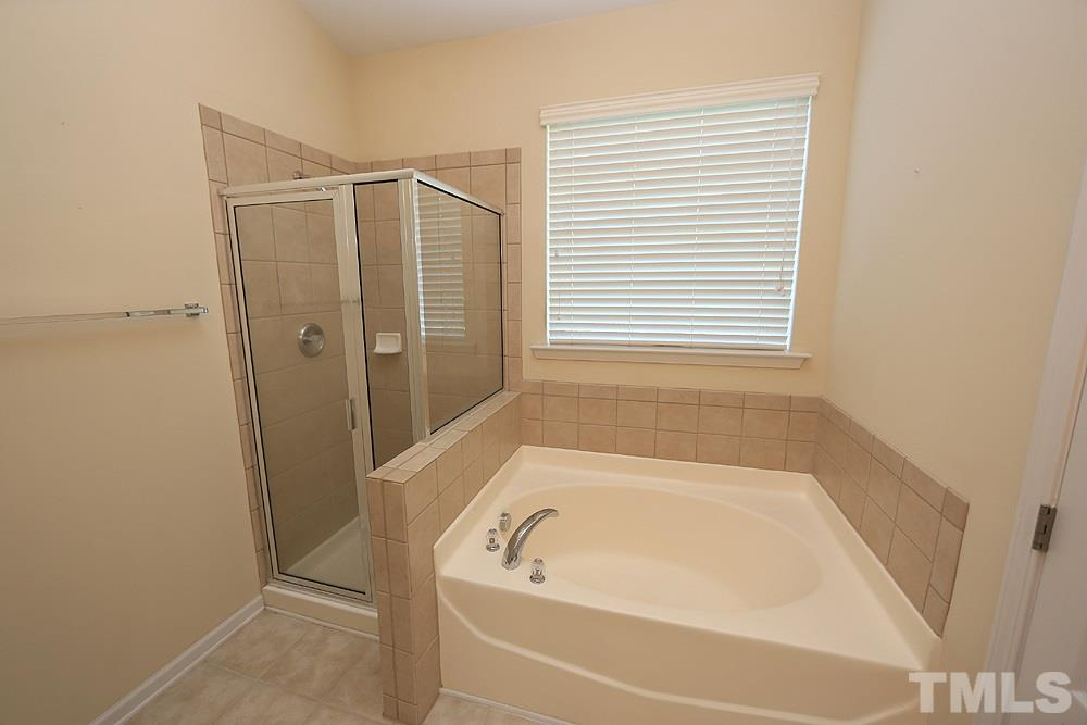 All of the builder upgrades -- all tile flooring (in all baths), tile shower surround (no plastic insert shower here), tile surround garden tub, dual sink vanity...beautiful!