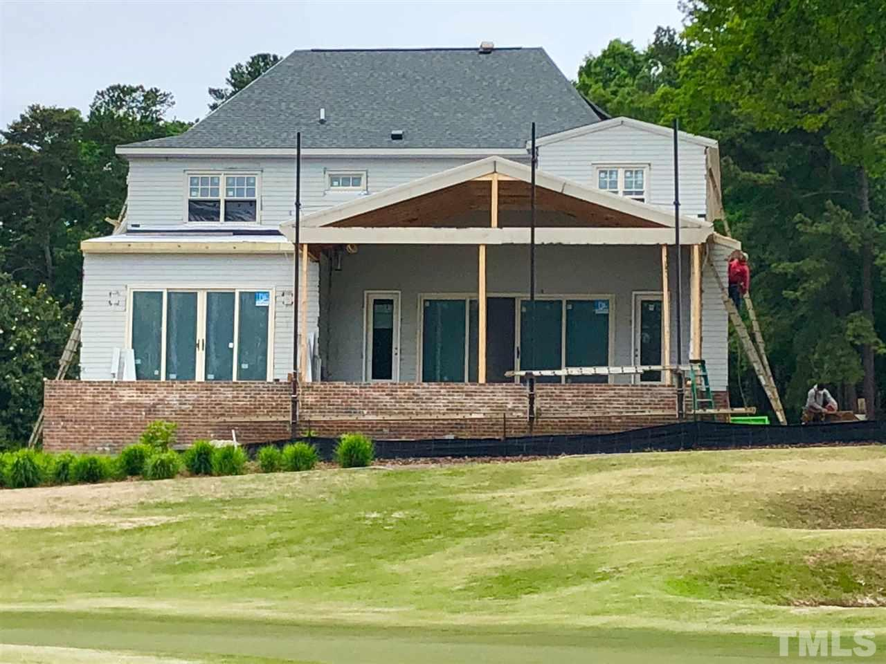 As Seen From The 12th Green Of The Lakes Course  On North Ridge Golf Course.  Screen Porch and Raised Patio Will Have A Wonderful View Of The 12th Greens On The Lakes Course at North Ridge