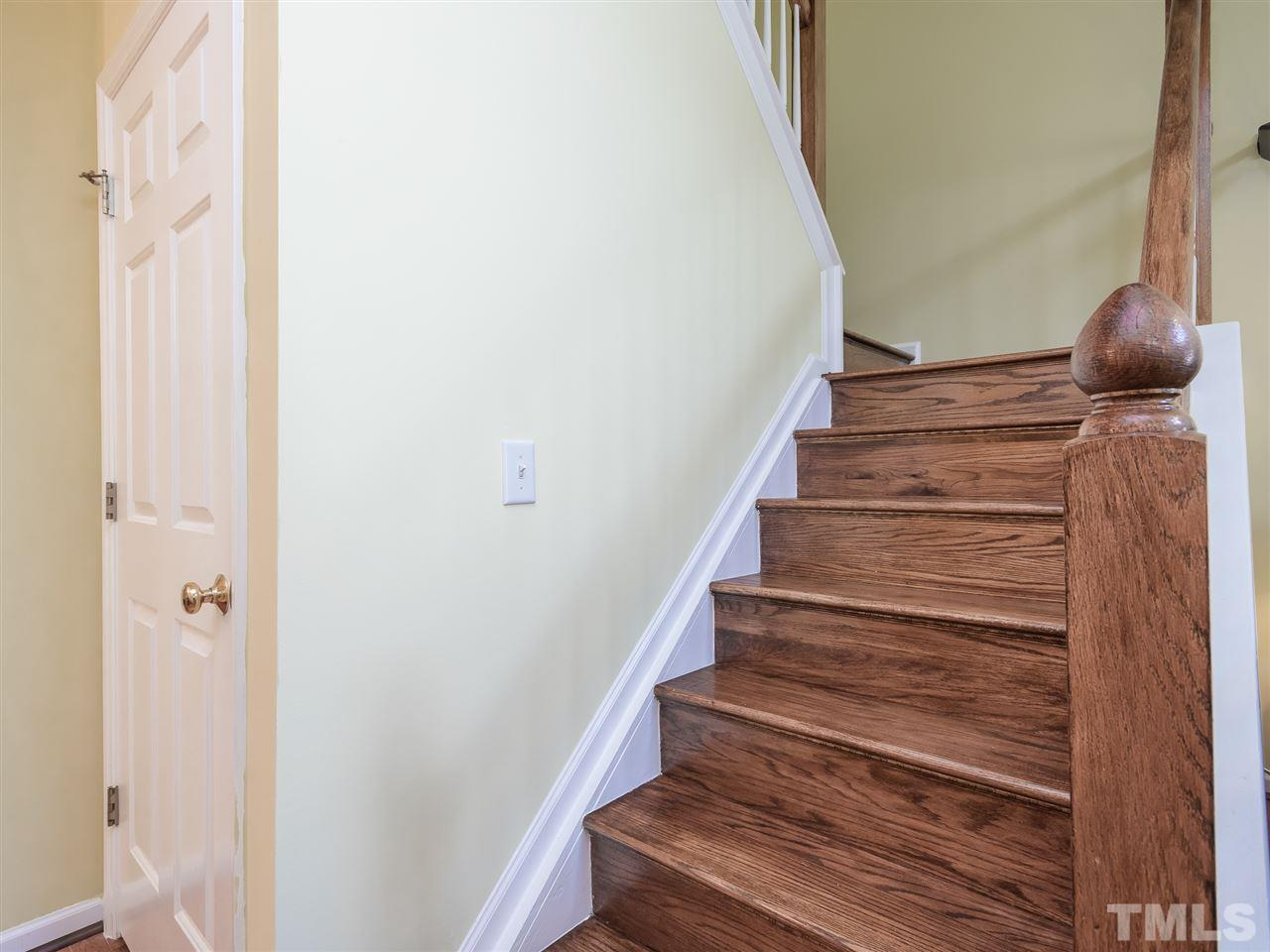 Wood stairs! There is no carpet in this home! All bedrooms upstairs.