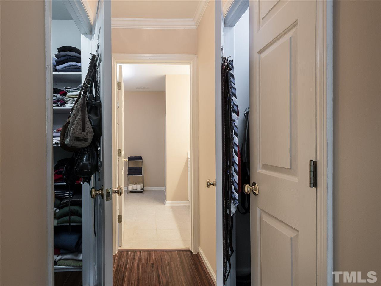 Dual closets in hall towards master bath!